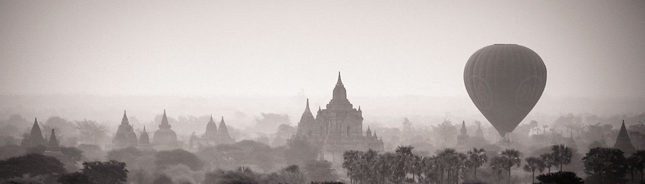 Myanmar (Burma) Bagan sunrise with balloon over temples