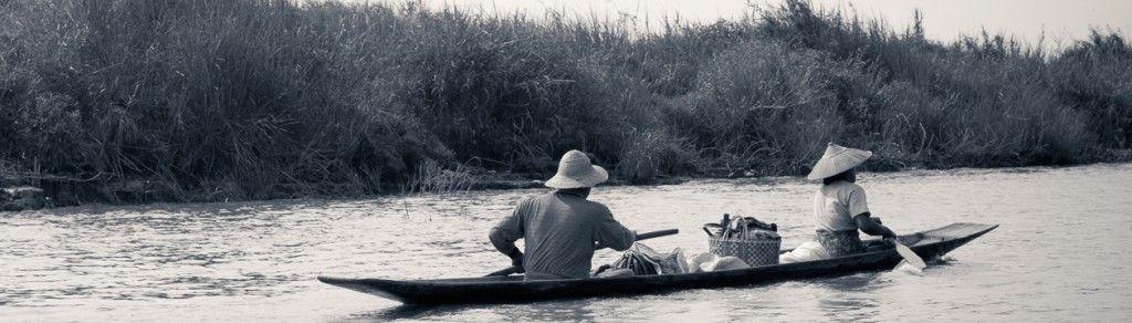 Myanmar Burma Lake Inle sunrise people rowing in wooden canoes