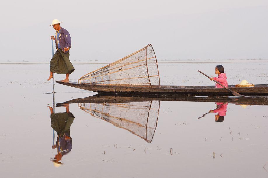 Inle lake, Myanmar (Burma) fisherman with girl on boat
