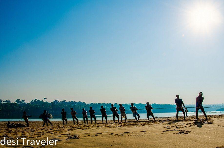 Fishermen on beach in Kerala