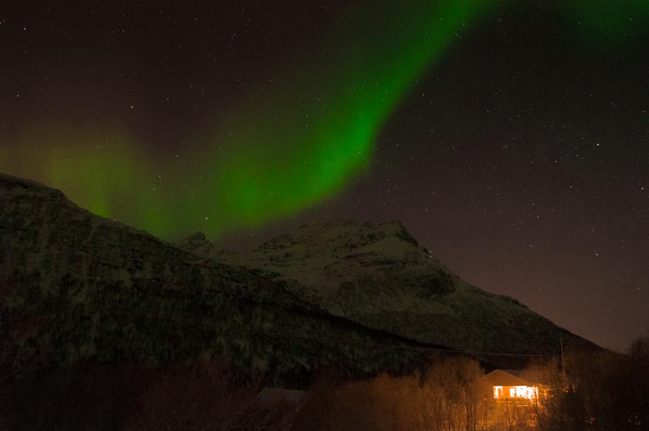 5_Stunning Aurora Borealis over a cottage near Tromso