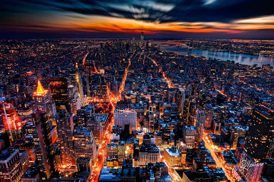 Broadway, the 5th and the 6th Avenue (Avenue of the Americas) illuminated, like the arteries of a giant living being, and shot from the top of the Empire State Building after the sunset, during the blue hour, when the City begins to switch on his lights. The cars draw long trails on the camera film, the gold of the pinnacles shimmers as the sky turns to dark purple.. I can say I've traveled to NY to obtain exactly this photo for my collection.. The picture is composed of 5 long exposition HDR (from till 30secs) printed on a big surface reveals an incredible number of invisible small particulars. The native resolution is 34.1Mp (7148x4764) and can be printed without loosing details up to huge dimensions.