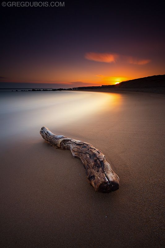 Nothing better than being at the beach early in the morning. I found this awesome piece of driftwood and was able to  get a cool angle for sunrise. The drift wood stayed anchored as the surf washed around it for this 4 minute exposure.  LEE Filters Big Stopper (10 stops) LEE Filters Hard-Edge 1.2 GND (4 stops) LEE Filters Soft-Edge 0.9 GND (3 stops)
