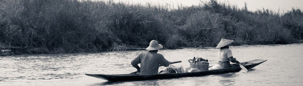 Myanmar Burma Lake Inle sunrise people rowing in wooden canoes