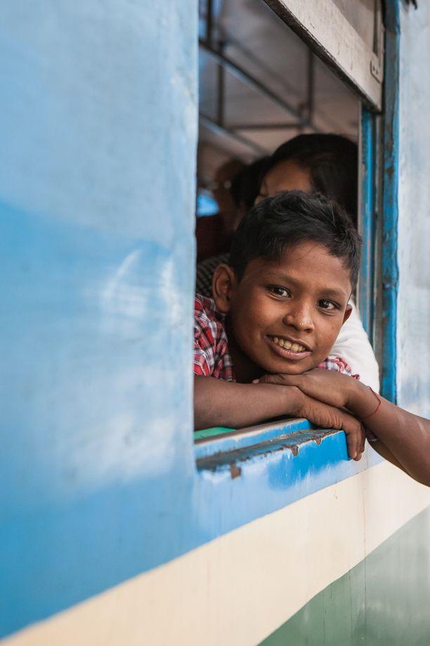 Myanmar boy looking out of train window