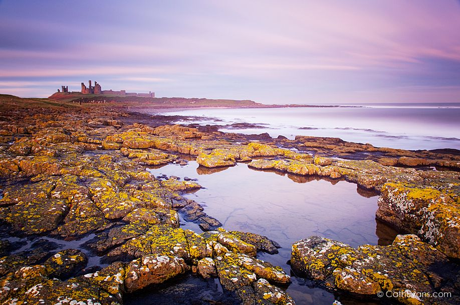 Dunstanburgh Castle and Coast at Twilight