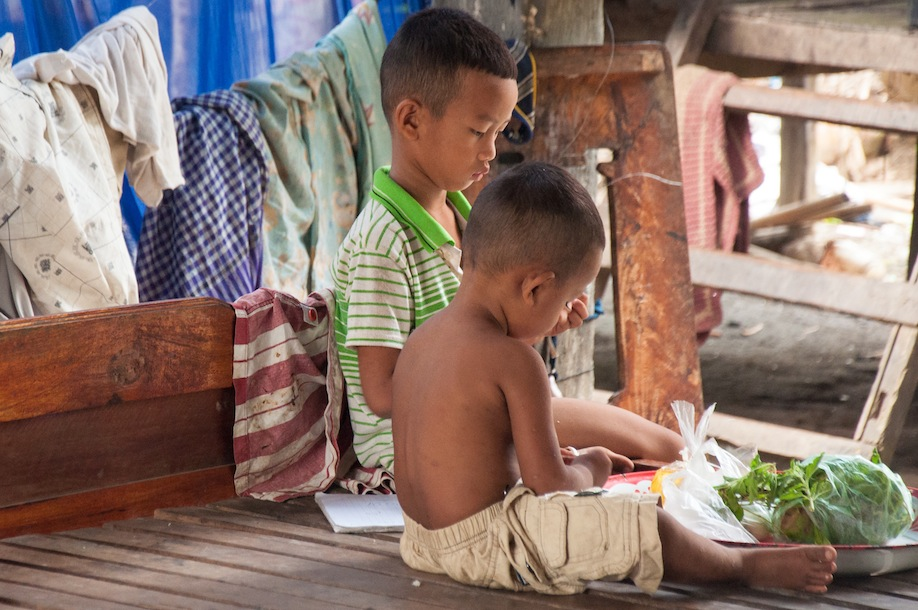 10_A couple of brothers in rural Cambodia helping prepare vegetables for lunch
